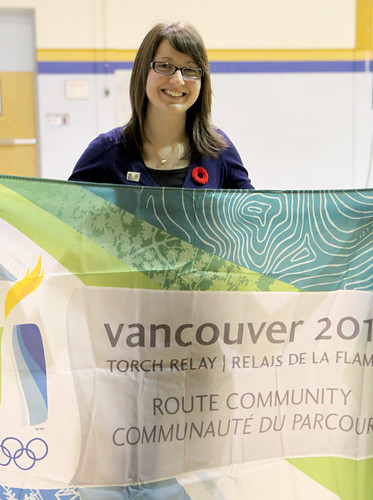Michelle Arsenault hold a 2010 Torch Relay Flag. Michelle was selected as an Honorary Torch Bearer for the Dryden leg of the Olympic Torch Relay.