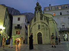 orthodox priest at nightfall in front of his church (redstarpictures) Tags: church pen kirche olympus dmmerung balkans orthodox montenegro nightfall ep1 balkan kotor priester crnagora bayofkotor   kotorbucht