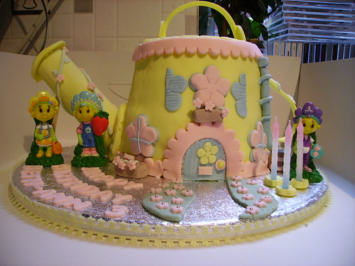 Fifi watering can house with figures cake