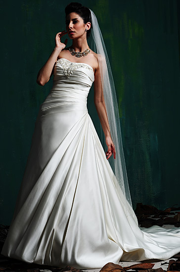 Wedding gown with crystal accents and beads.