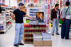 employee displays the goods (kate at yr own risk) Tags: sanfrancisco california mission missionstreet obamania