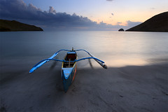 Linger (nathan gonzales) Tags: ocean longexposure sunset sea sky mountain lake seascape water misty canon landscape asian boat interesting rocks asia skies native philippines creative shore filipino local pinoy banca anawangin canon30d nathangonzales