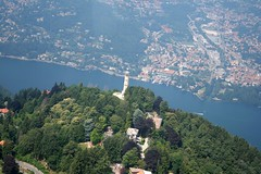 Como lake - Il faro Voltiano (_ Night Flier _) Tags: above city travel blue sky italy panorama lighthouse lake como green rooftop nature water airplane landscape town flying high view earth top aviation aerial h2o fromabove coastline lombardia cessna skyview lagodicomo lombardy brunate birdeye aeronautic farovoltiano leflritlagodicomovoltiano