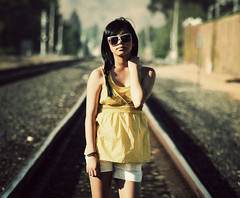 She got the gift of gravity pulling to ask her name (margyyy) Tags: girl yellow train asian azn tracks filippino