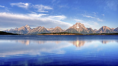 Teton Range over Jackson Lake (woodchuckiam) Tags: travel usa mountain lake mountains reflection nature landscape landscapes nationalpark scenery lakes scenic tourist jackson wyoming mountmoran grandteton grandtetonnationalpark jacksonlake cathedralgroup woodchuckiam