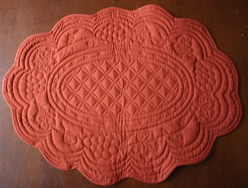 An oval quilted <span class=