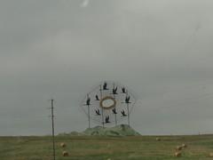 DSC00435.JPG (hernameisali) Tags: iris sculpture eye flying geese highway structure telephonepole telephonewires pupil