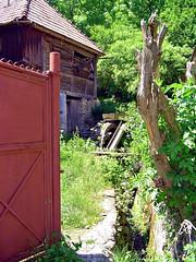 The old water mill (CameliaTWU) Tags: mountains canal gate village oldhouse romania stump transylvania woodhouse watermill redgate apuseni tileroof carpathian metalgate millwheel bedeciu