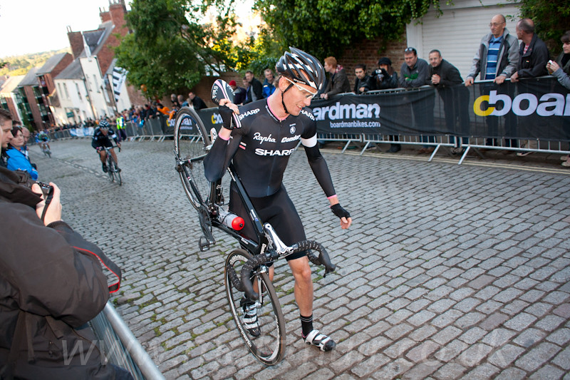 Zak Dempster walks up the long, steep cobbled climb for the 2nd time in the space of 10 minutes