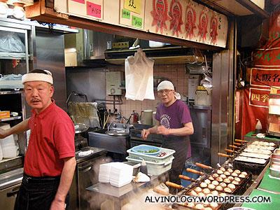 Fierce-looking takoyaki chefs