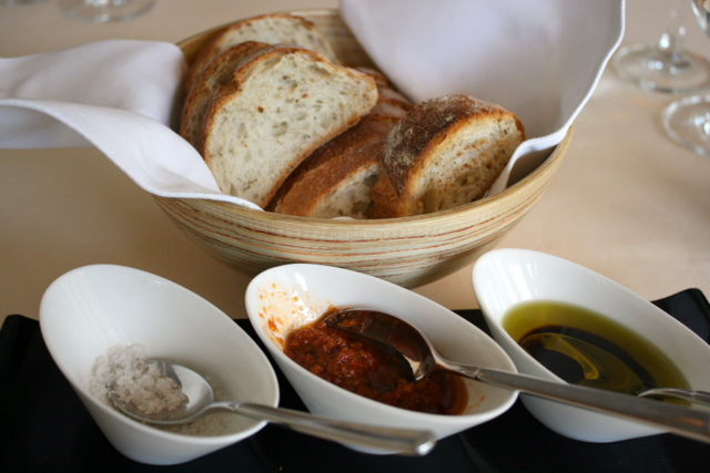 Warm bread with three condiments