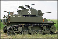 An M3 or M5 Stuart Tank ... aka Light Tank M3 or M5 (thegreatlandoni) Tags: usa history classic museum america vintage army photography airport cool war colorado gun track photographer technology tank unitedstates military sony awesome wwii memories machine exhibit denver airshow restore weapon memory cannon ww2 restored historical restoration hudson preserved mavica patriotism tread past amateur distillery turret obsolete usarmy worldwartwo unitedstatesarmy adobephotodeluxe olivedrab vintagetechnology omot plattevalley ftlupton landoni mvccd1000 thegreatlandoni jimlandon ourmemoriesourtimes lafayettefoundation