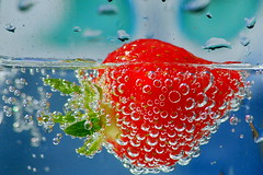 strawberry dropped in sparkling water!! (pomfrog) Tags: blue red summer colour green wet water sunshine fruit fun strawberry bright creative vivid sunny bubbles drop splash refreshing watersplash waterart fastshutter fastshutterspeed splashes fruitsplash frozenmotion fruitdrop freezingmotion