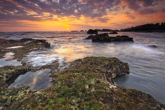 the fading of the day (tropicaLiving - Jessy Eykendorp) Tags: light sunset sea sky bali seascape beach nature water silhouette clouds indonesia landscape coast rocks shoreline tanahlot canggu efs1022mmf3545usm outdoorphotography canoneos50d tropicaliving hitechfilters mengeningbeach rawproccessedwithdigitalphotopro tiffproccessedwithadobephotoshopcs3 thefadingoftheday