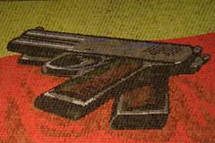 Children holding placards depicting a pistol (xeno_sapien) Tags: show children asia gun dancers propaganda korea kimjongil weapon pistol dictator socialism northkorea placards firearm pyongyang spectacle dprk kimilsong arirang massgames