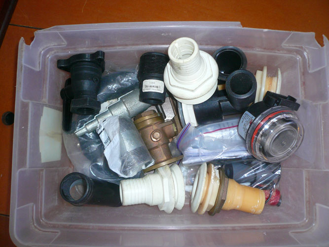 Another box of misc plumbing parts.  Spare Thru hull, deck drains, filters, etc