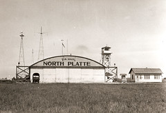Photograph of airmail hanger in North Platte, Nebraska (Smithsonian Institution) Tags: blackandwhite building rural town nebraska mail farm aviation garage hangar postoffice northplatte antennas airmail 1924 smithsonianinstitution usmail guardtower ruralpostoffice northplattene nationalpostalmuseum northplattenebraska firstairmail postofficw nationaldelivery northplattepostoffice