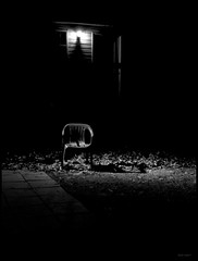 Darkness (photo_secessionist) Tags: bw film night zeiss 35mm blackwhite chair poetry shadows darkness kodak tripod contax vultures depression mybackyard outtake bw400cn contaxiii zeiss1155cmsonnarlens anonisasneakywayofsayingme