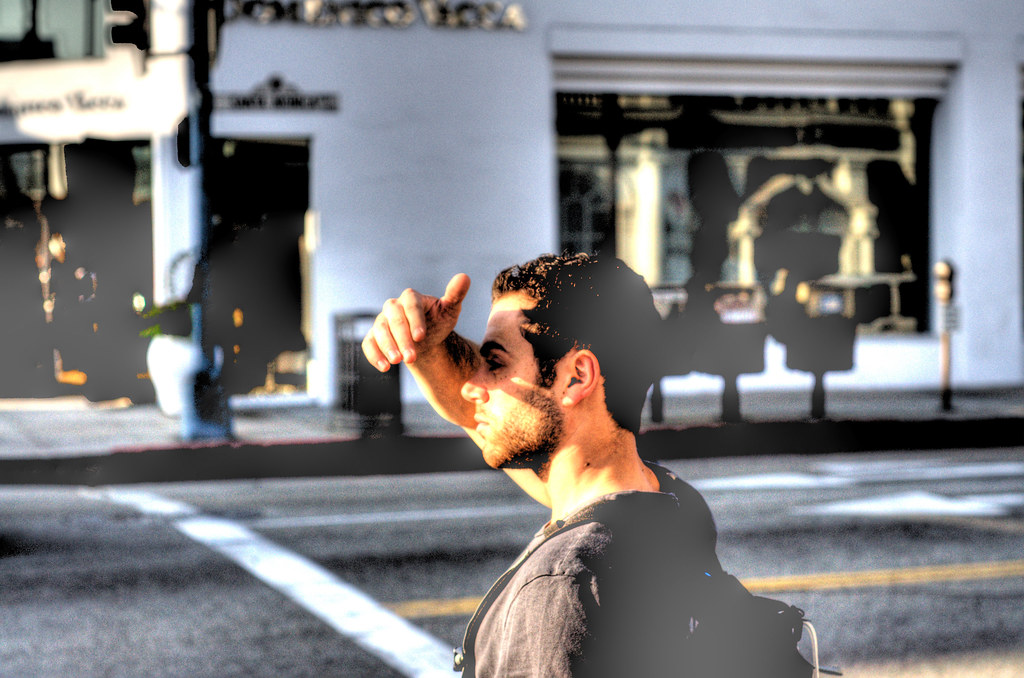 Joel blocking the sun on the streets in Beverly Hills.