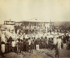 Reading the proclamation of annexation, Mr Lawe's house, Port Moresby, New Guinea, November 1884 / photographer John Paine or Augustine E. Dyer (State Library of New South Wales collection) Tags: queensland imperialism unionjack unionflag annexation colony newguinea portmoresby royalnavy royalnavyensign papuans