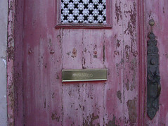 pink door with correo slot