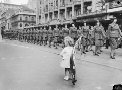 A child watches the march, 1942 (Australian War Memorial collection) Tags: birthday army happy women flickr child flag military australia melbourne victoria parade worldwarii patriotism armedforces secondworldwar awas australianwarmemorial    eyesright    commons    australianwomensarmyservice commons:event=commonground2009 happybirthdayflickrcommons