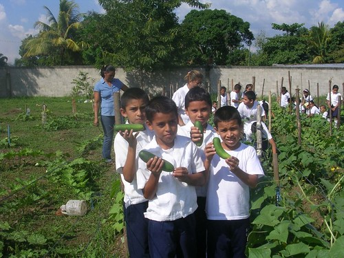 Landa kids with vegetables.jpg