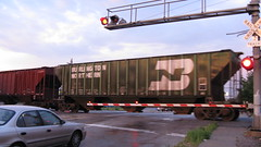 A former Burlington Northern RR covered hopper in transit crosses Archer Avenue. Chicago Illinois. August 2009.