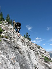 Scrambling up east slope of Mt. Rundle, Alberta, Canada. (gerry.bates) Tags: mountainlandscape rockymountains kananaskisprovincialpark hiking outdoorrecreation nature people children alberta canada canon rundlemountain leisureactivity ridge ledge scrambling onechild boy