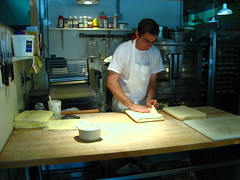 The pastry chef at work. Thats a stack of butter slabs on the left there.