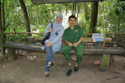 Pose with mas-mas Vietkong. See my high heels? Bad idea!