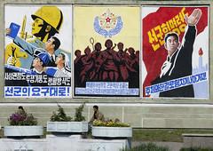 Pyongyang propaganda posters - North Korea (Eric Lafforgue) Tags: road street poster army war asia propaganda bikes korea asie rue coree northkorea dprk coreadelnorte 3643 nordkorea    coreadelnord   insidenorthkorea  rpdc  kimjongun coreiadonorte