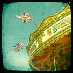 (_cassia_) Tags: blue red white blur shop vintage typography lights amusement pier brighton decoration carousel flags british rides etsy dust ornate merrygoround unionjack imperfection ttv throughtheviewfinder cassiabeckcom brightonflickr2009bookpick