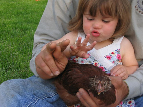 Lil' M telling her chicken that she is now 2