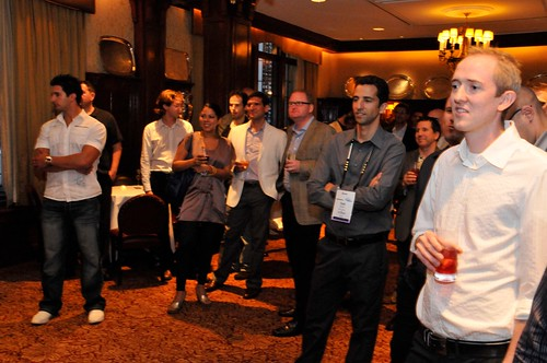 A crowd of top-earning ClickBank clients listen to Terra Goeres speak