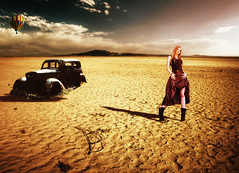 Fashion victim (Claudio.Ar) Tags: santafe argentina car fashion lady photomanipulation women loneliness desert artistic victim balloon sensational legacy ourtime greatphoto magnumopus topf450 thecitadel 333views littlestories photographia ima