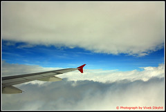 Flying zone (Vivek Dikshit) Tags: blue red sky india white fog clouds plane flight wing aeroplane kingfisher indore mumbai canon1000d vivekdikshit