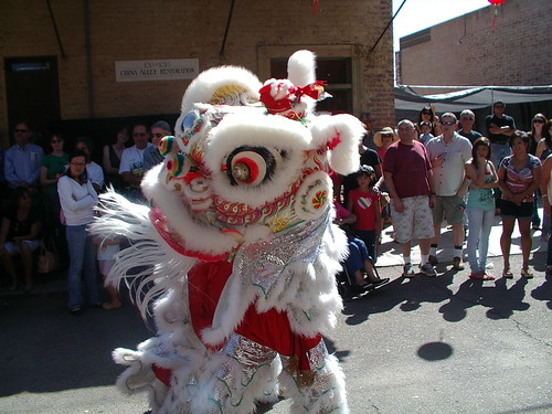 white lion dancers