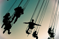 Flight (abbyladybug) Tags: sky silhouette fun fairgrounds flying swings flight northcarolina fair raleigh explore 2009 northcarolinastatefair ncstatefair ncstatefair2009