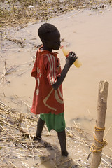 Boy drinking dirty water