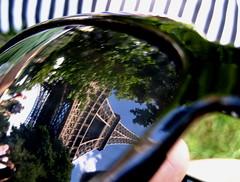 Eiffel Lens (Stephanie Wesolowski) Tags: blue trees sky distortion black paris france macro reflection green grass sunglasses lens europe day dof stripes eiffeltower sunny eiffel tourist structure depthoffield reflexions