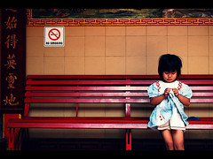 Little Girl at The Vihara (khaniv13) Tags: red girl 35mm indonesia temple nikon waiting little couch sit f18 bogor vihara d40x earthasia dhanagun khaniv13