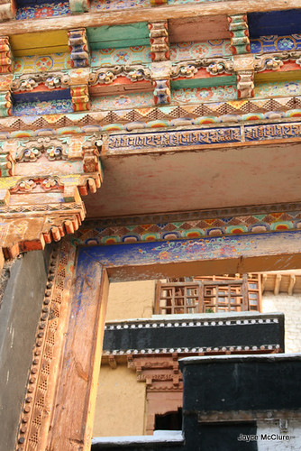 Painted, carved exterior doorway and wall at Thiksey Monastery, Ladakh Region, India