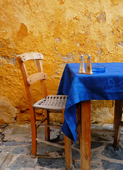 The well of the Turk (ssj_george) Tags: leica wood old blue summer food brown yellow wall table pepper island lumix restaurant wooden chair pavement stones decay salt holes well panasonic greece crete ash tray ashtray cracks cloth 1001nights turk chania        canea  fz28  ssjgeorge