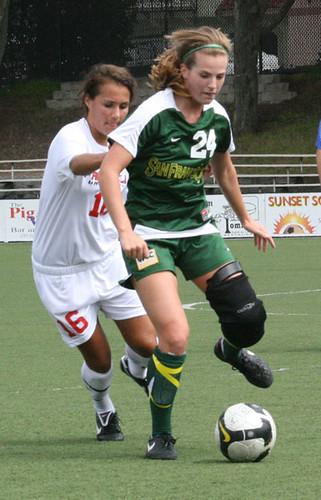 Freshman Joan Piasta gaurds the ball against an attacking Fairfield player.  Melissa Stihl/Foghorn