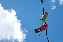 Hung Up (Design.Her) Tags: blue sky newmexico art colors clouds graffiti wire nikon shoes downtown bright albuquerque hanging chale nm nese telephonewire coloful d90 designher