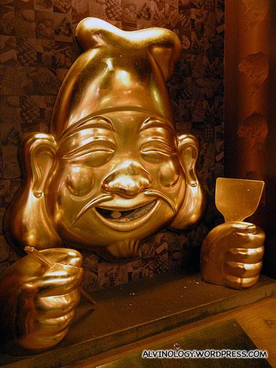 Gold moustache man statue