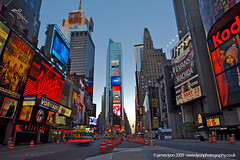 Early Morning - Times Square, New York City, USA (lyon photography) Tags: street nyc light usa ny newyork clock america dawn movement neon quiet skyscrapers unitedstates lyon pavement empty taxi earlymorning noone icon sidewalk timessquare tall essence typical visual iconic bigapple virus deserted symbolic firstlight definitive epidemic pandemic devoid thecitythatneversleeps adverting jameslyon wwwlyonphotographycouk