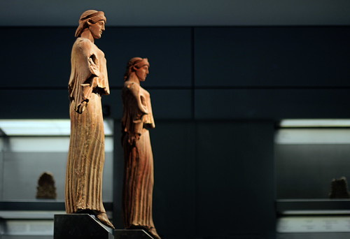 the acropolis slopes:  two terracotta nike statues, 1st-3rd c.AD