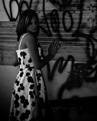 Grafitti and Destruction (Nikerley) Tags: light portrait blackandwhite bw woman white house black flower sexy abandoned girl female barn neglect dark fun illinois scary model nikon dress photoshoot dirty il dirt ill abandon d40 nikond40